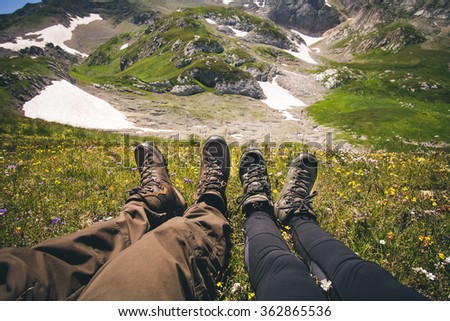 Couple Feet Man and Woman in love relaxing outdoor Travel Lifestyle and feelings relationship concept mountains on background Summer vacations - stock photo
