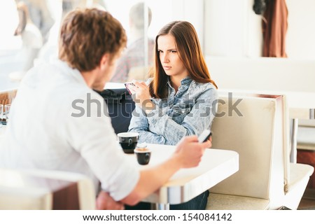 Couple fighting in cafe Relationship problems - stock photo