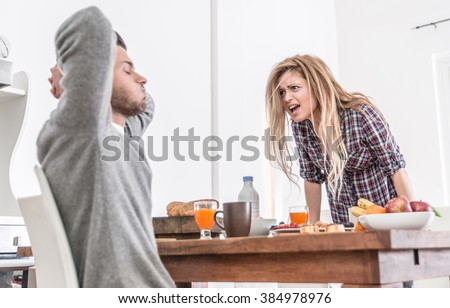Couple fighting in the morning. woman screaming to her man. relationship problems - stock photo