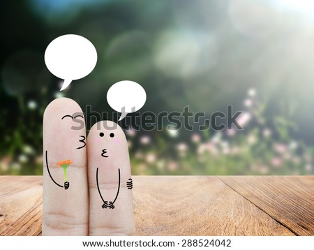 Couple Finger in love and bubble chat on wood floor and bokeh  background , concept - stock photo