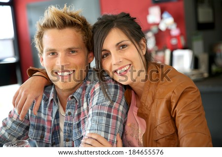 Couple gathering with friends at lunch time - stock photo