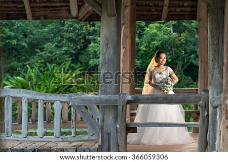 couple getting married shot outdoor in a field with selective focus and color tone adjust ment in post process - stock photo