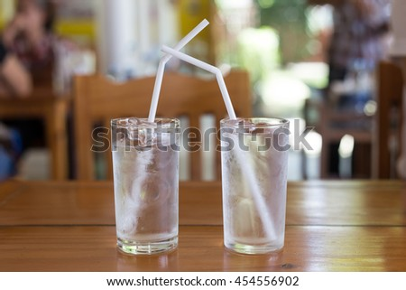 Couple Glass Water With White Tube On Wood Table,Selective Focus