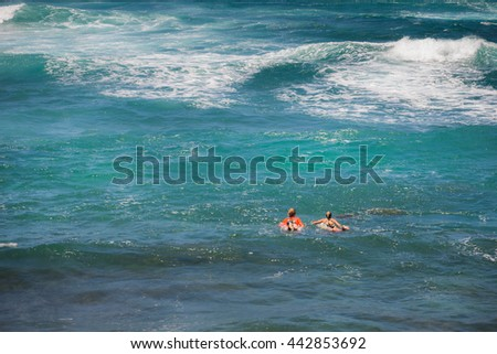 Couple go surfing in the ocean, Maui Hawaii - stock photo