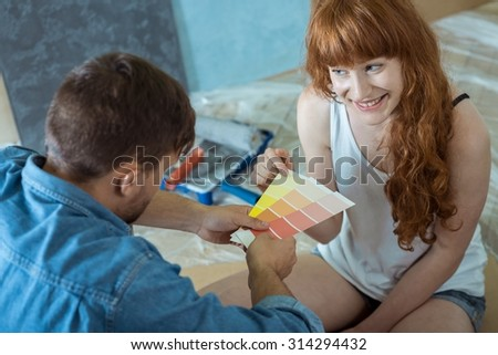 Couple going to painting walls for yellow color - stock photo