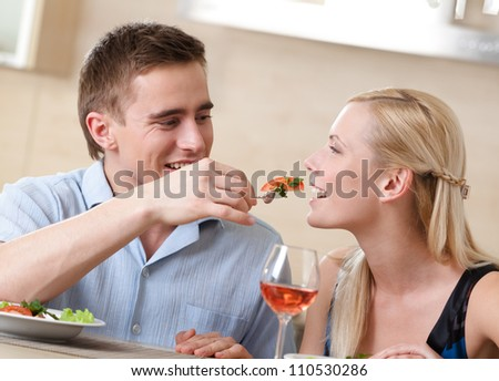 Couple has romantic supper in the kitchen - stock photo