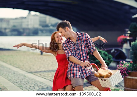 Couple have fun riding on bike - stock photo