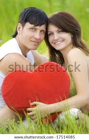 couple have happiness with heart in field - stock photo