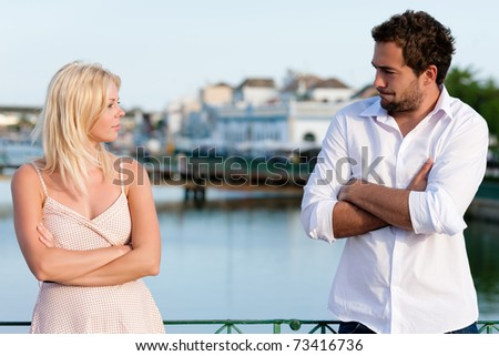 Couple having a discussion in summer in their vacation - stock photo