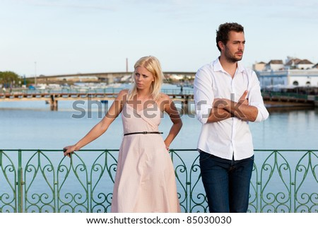Couple having a discussion in summer in their vacation