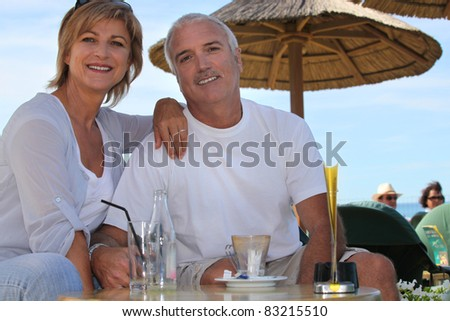 Couple having a drink - stock photo