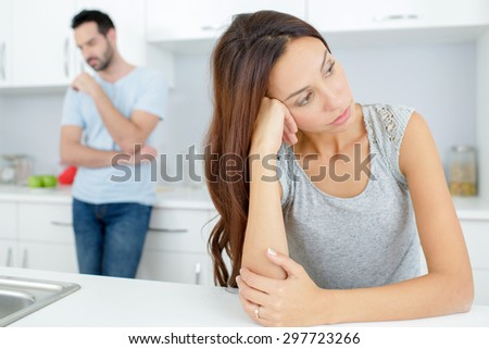 Couple having an argument in the kitchen - stock photo