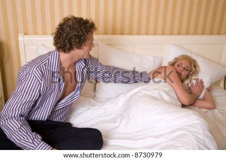Couple having an argument where the man is trying to solve it - stock photo