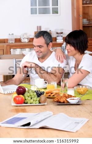Couple having breakfast together - stock photo