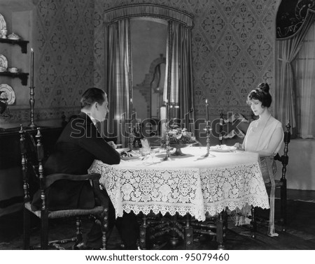 Couple having formal dinner at home - stock photo