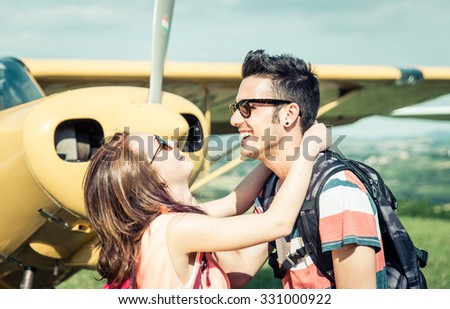 Couple having fun during an excursion. laughing and smiling before getting on the plain - stock photo