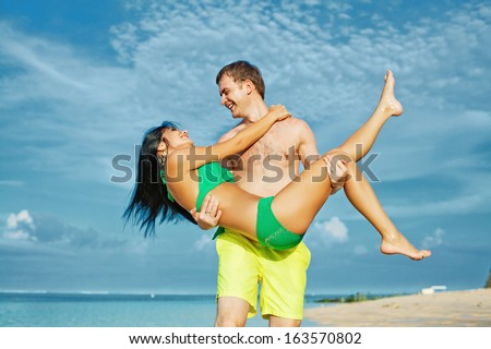 couple having fun on a beach