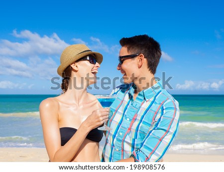 Couple having fun on the beach. Celebration concept.
