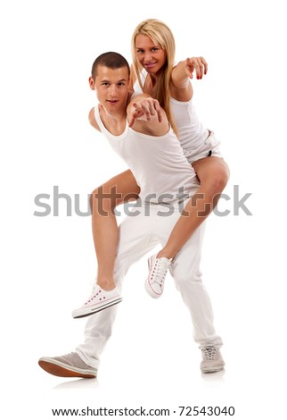 couple having fun pointing at the camera over a white background - stock photo