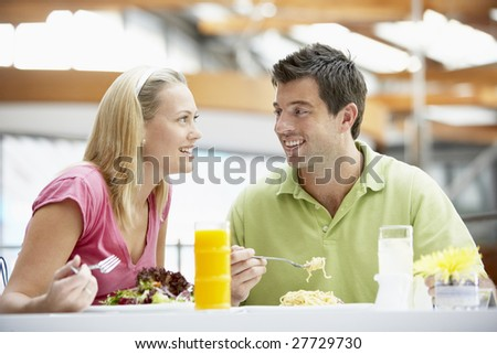 Couple Having Lunch At The Mall - stock photo
