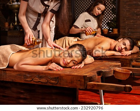 Couple  having oil Ayurveda spa treatment. - stock photo