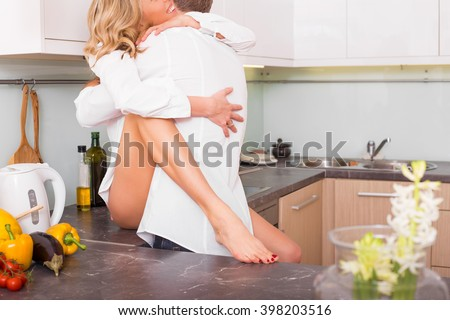 Couple having sex on kitchen counter  - stock photo