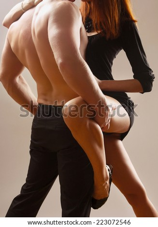 couple heterosexual topless with jeans detail studio shot - stock photo