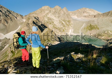 couple hiking in mountain - stock photo