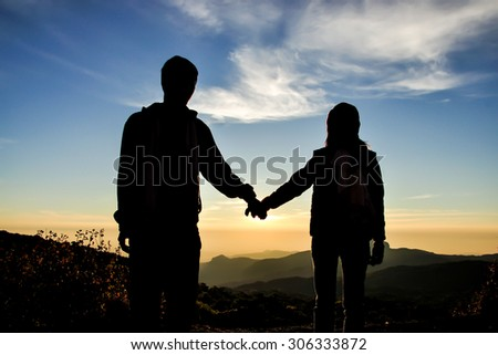 Couple hold hand on sunrise scene, famous mountain in north of Thailand - stock photo