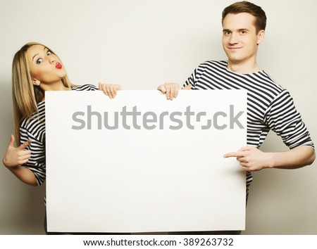 Couple holding a banner  - stock photo