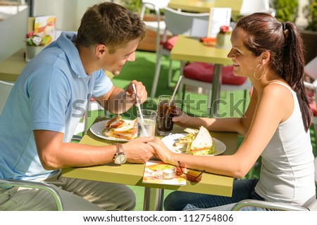 Couple holding hands flirting at cafe happy woman man loving - stock photo