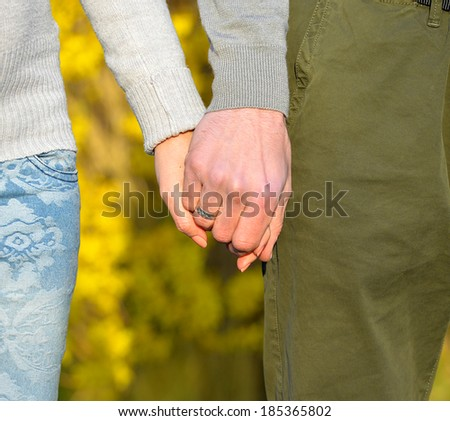 couple holding hands. heart of hands - stock photo