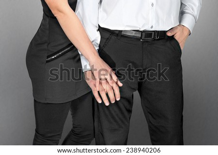 couple holding hands in classical clothes