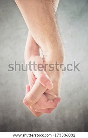 Couple holding hands. Man and woman holding hands, close up. - stock photo