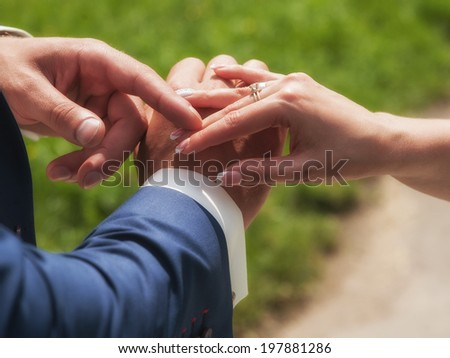 Couple holding hands outdoors feeling