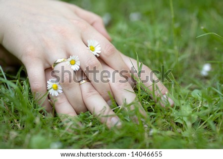 Couple holding hands with wedding rings - stock photo