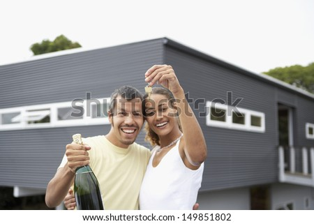 Couple holding keys for new house