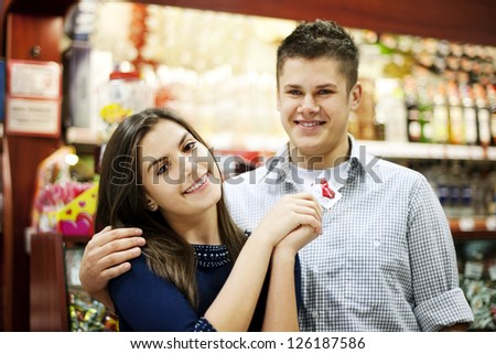 Couple holding lollipop in their hands
