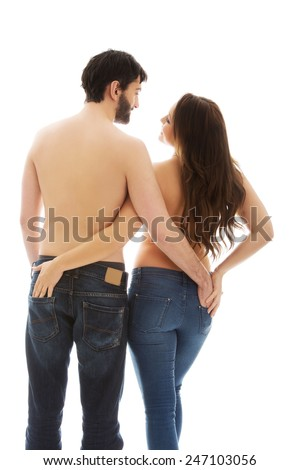 Couple holding their hands in each other jeans pocket. - stock photo