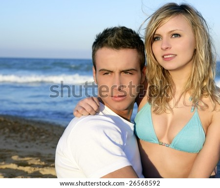 Couple hug on the blue beach, summer sunset - stock photo