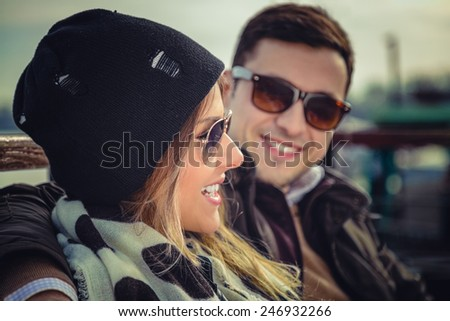 Couple hugging and smiling - stock photo