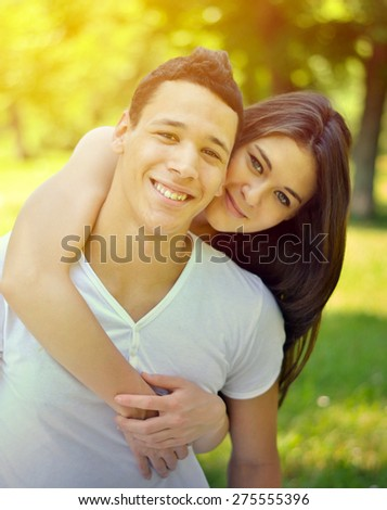 Couple hugging in a park
