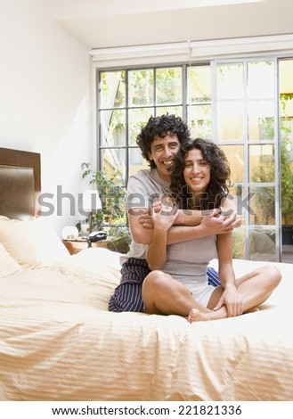 Couple hugging on bed