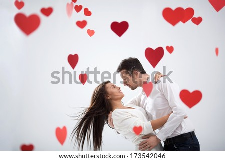 Couple hugging on white background - stock photo