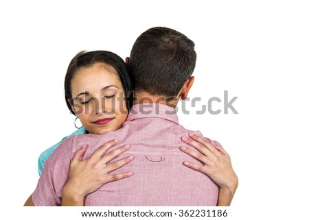 Couple hugging on white background