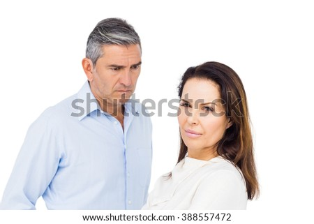 Couple ignoring each other against white background - stock photo