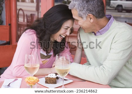 Couple in a Cafe - stock photo