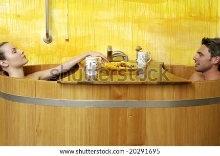 Couple in a mountain spa - stock photo