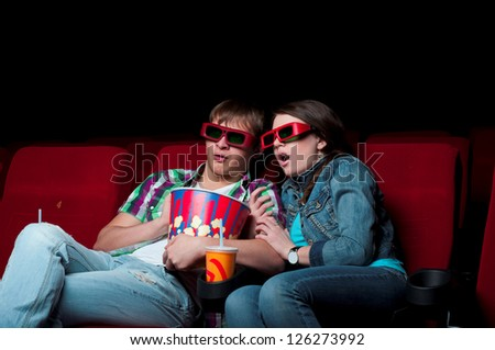 couple in a movie theater, watching a 3D movie - stock photo