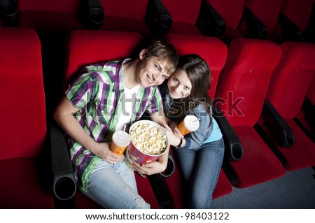 couple in a movie theater, watching a  movie - stock photo